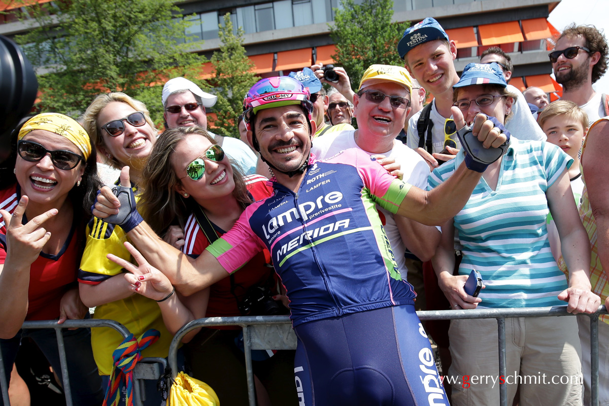 Jose Serpa (Lampre Merida) is posing with Fans before start in Utrecht @ stage Tour of TDF 2015