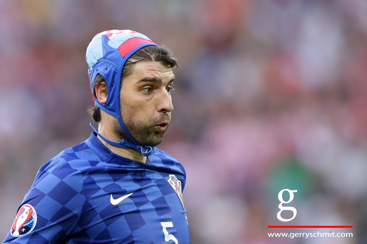 Portrait of Verdan Corluka (Croatia) who wears a head protection after an injury