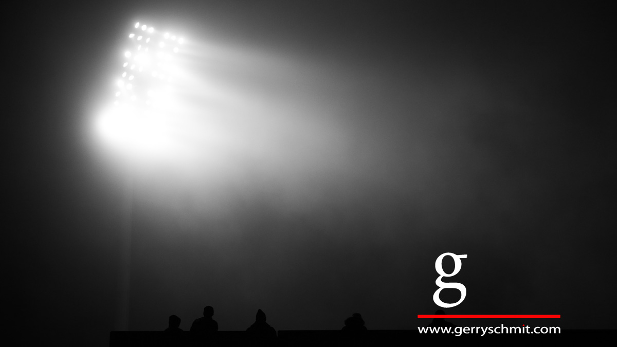 Spektators watch the floodlight game Luxembourg - Belarus in the fog